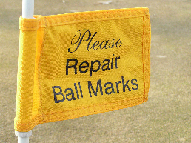 repair-ball-marks-sign
